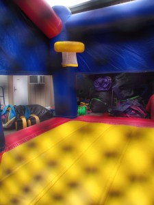 Super hero bounce house combo basketball goal