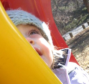 Mimi, on her favorite McDonald's colored swing at the playground.