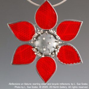 """Reflections on Nature,"" sterling silver and bicycle reflectors, by L. Sue Szabo. Photo by L. Sue Szabo."