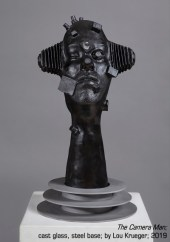 """The Camera Man"" cast glass sculpture by Lou Krueger"