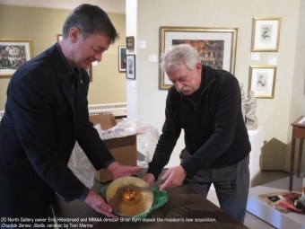 20 North Gallery owner Eric Hillenbrand and MMAA director Brian Byrn unpack the museum's new acquisition by Tom Marino