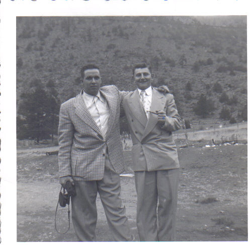Dad and his friend John Rovison in Idaho Springs, CO waiting while they fix a flat tire. On leave in May of 51