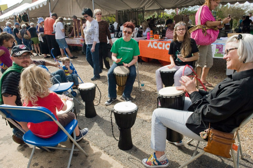 A photo of a drum circle taking place at the Texas Avenue Makers Fair