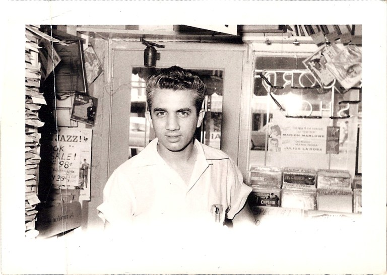 A photo of Stan Lewis inside of Stan's Record Shop, circa 1955