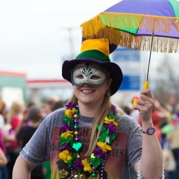 A photo of a Mardi Gras parade goer