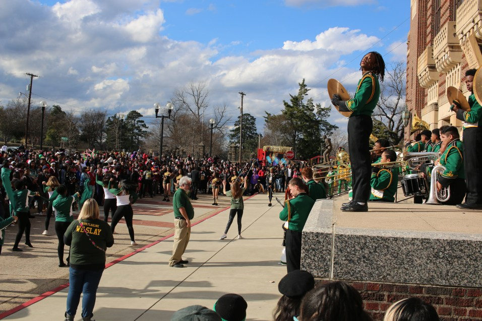 A marching band performs on the steps of Shreveport Municipal Auditorium following the Krewe of Harambee Martin Luther King Jr. Day Mardi Gras Parade in Shreveport.