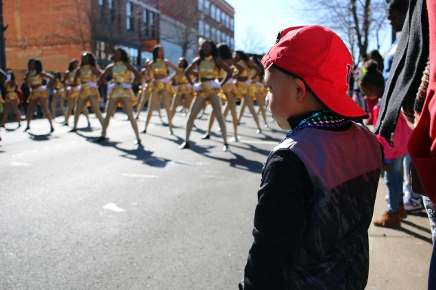 A young man watches the Krewe of Harambee Martin Luther King Jr. Day Mardi Gras Parade in Shreveport.