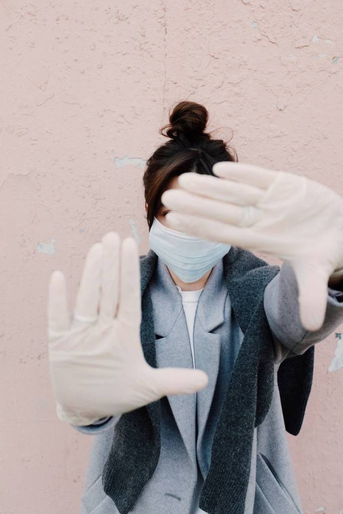 woman with face mask and latex gloves
