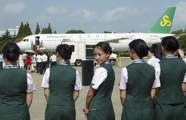 招考空姐如选美,若无姣好的面容,难以被录取。(Photo by China Photos/Getty Images)