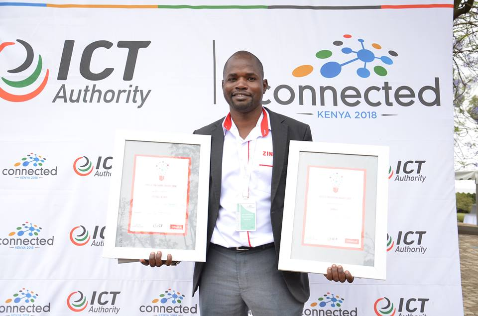 Kenyan award winning entrepreneur Gervase Jeneri Wakoli holds up to awards during the Connected Kenya -2018 conference he shares his personal story on failures in business