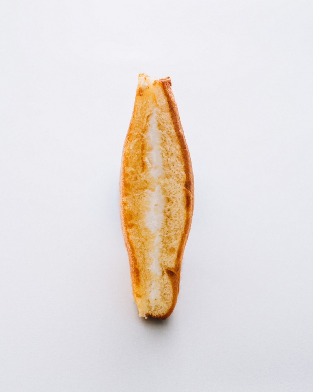 elliptical shaped bread with cream sandwiched illustrative of vaginal yeast infection