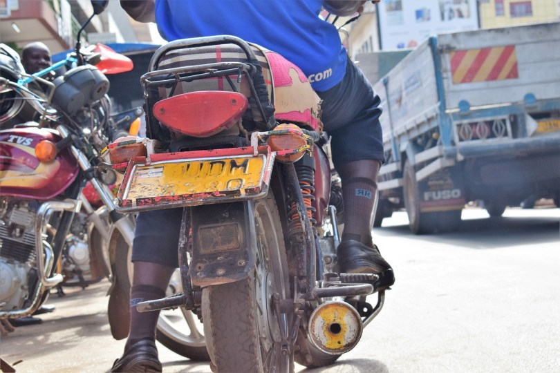 a male boda boda rider taken from behind at street level. also known as nduthi guy in Nairobi they are one of my heroes of COVID-19 Nairobi lockdown