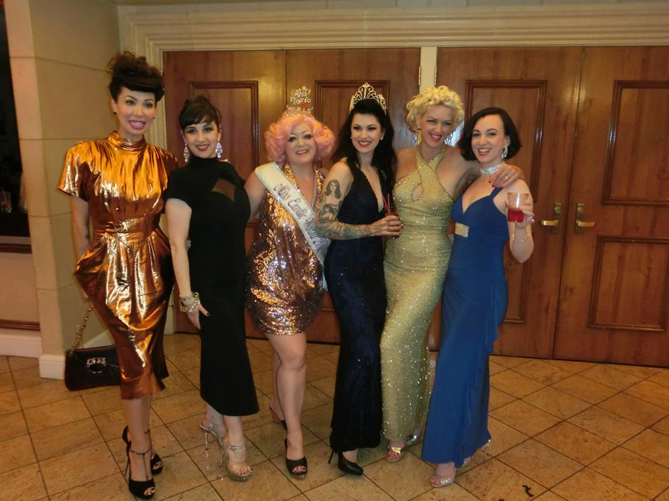 LouLou D'vil poses with previous Queens of Burlesque. Left to right: Kalani Kokonuts, Miss Indigo Blue, Dirty Martini, LouLou D'vil, Kitten DeVille and Michelle L'amour.  ©Thomas Hoffmann