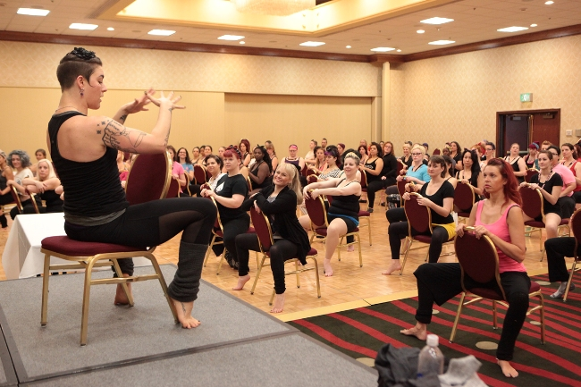 Lola Frost leading a class at BurlyCon 2013.  ©Don Spiro