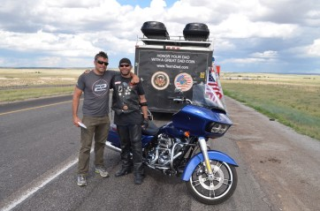 Biker Mike from OKC with Lincoln after receiving his Great Dad Coin.