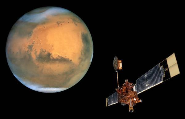 První fotografii družice, která obíhá kolem jiné planety, pořídila v těchto dnech americká sonda Mars Global Surveyor.