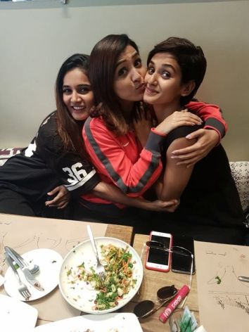 Justice Mohan is enjoying food with his sisters