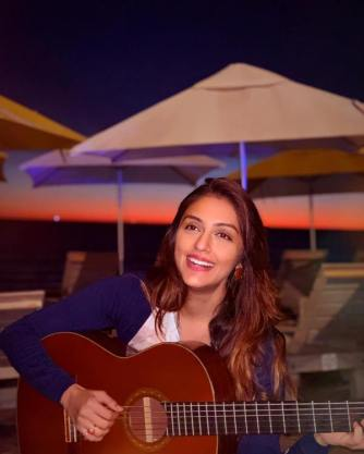 Aarti Chabria playing the guitar