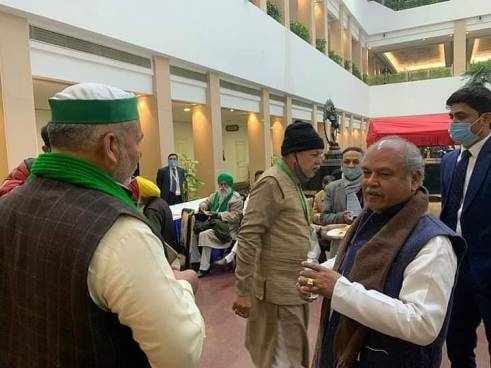 Rakesh Tikait having a word with the Indian agriculture minister Narendra Tomar at Vigyan Bhavan, New Delhi