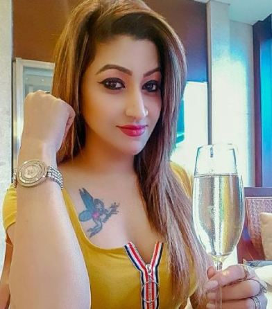 Roshni Kapoor with a glass of wine