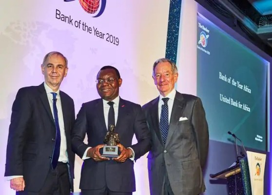 """CEO, UBA Africa, Mr Victor Osadolor(middle) with the """"African Bank of the Year 2019"""" won by United Bank for Africa(UBA) Group at The Bankers Awards held in London"""