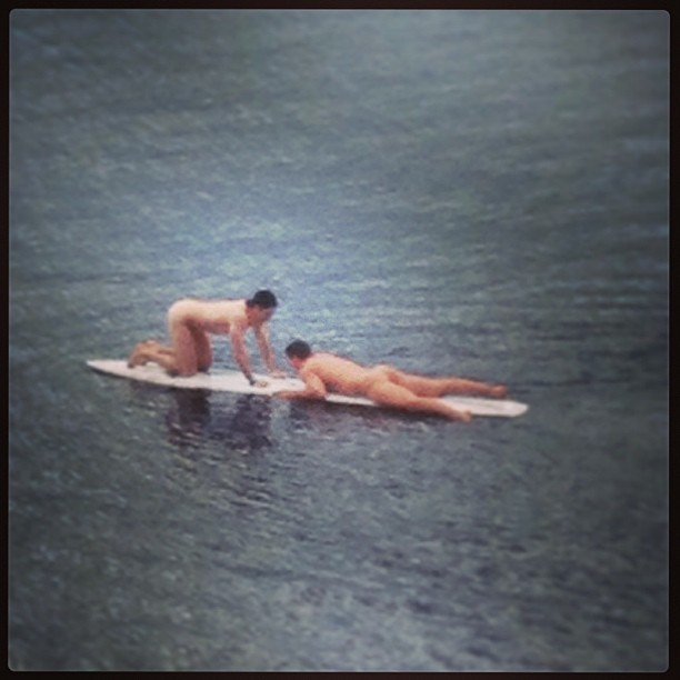boys surfing naked