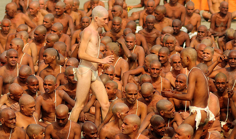 Allahabad, India: Newly initiated naked - 'naga' - sadhus perform rituals on the bank of the Ganga river during the Maha Kumbh festival. A sadhu is a wandering monk. There are four to five million sadhus in India today and they are widely respected for their holiness.Photograph: Sanjay Kanojia/AFP/Getty Images