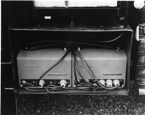 Two large FM two-way units in the trunk of an automobile, built by Motorola in 1940. Two-way radio's first use was with municipal police and fire departments.