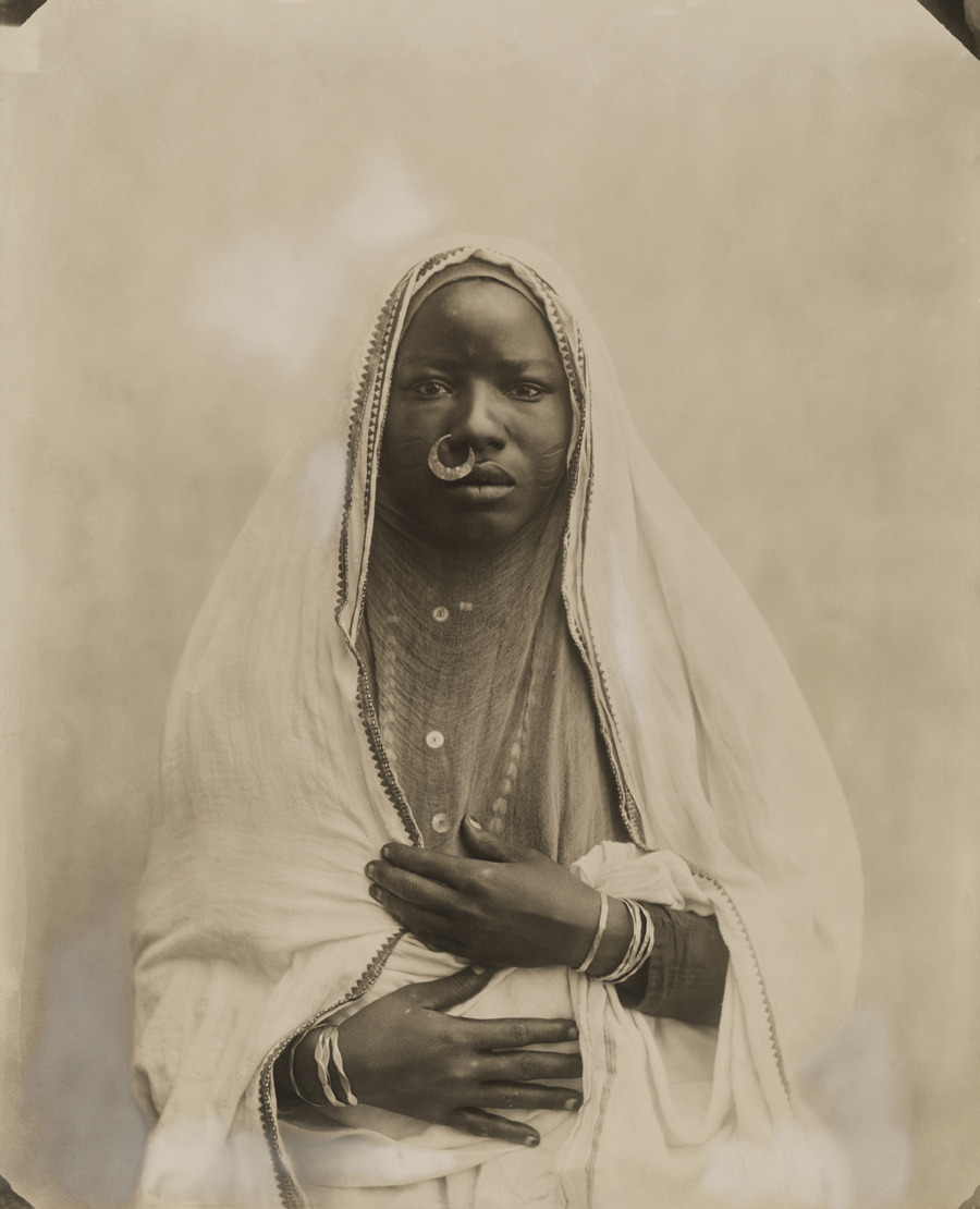 Portrait of a Sudanese woman from Kodak (Egypt) Ltd., purchased abroad by Maynard Owen Williams, 1920.Photograph by Kodak Ltd.