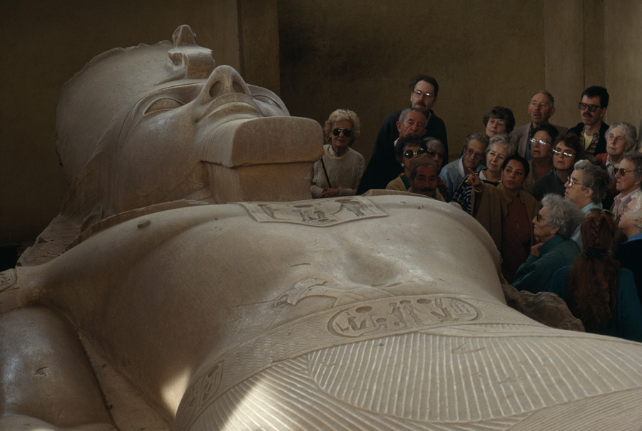 Museum tourists admire an enormous carving of Pharaoh Ramses II in Egypt, April 1991.Photograph by O. Lewis Mazzatenta, National Geographic