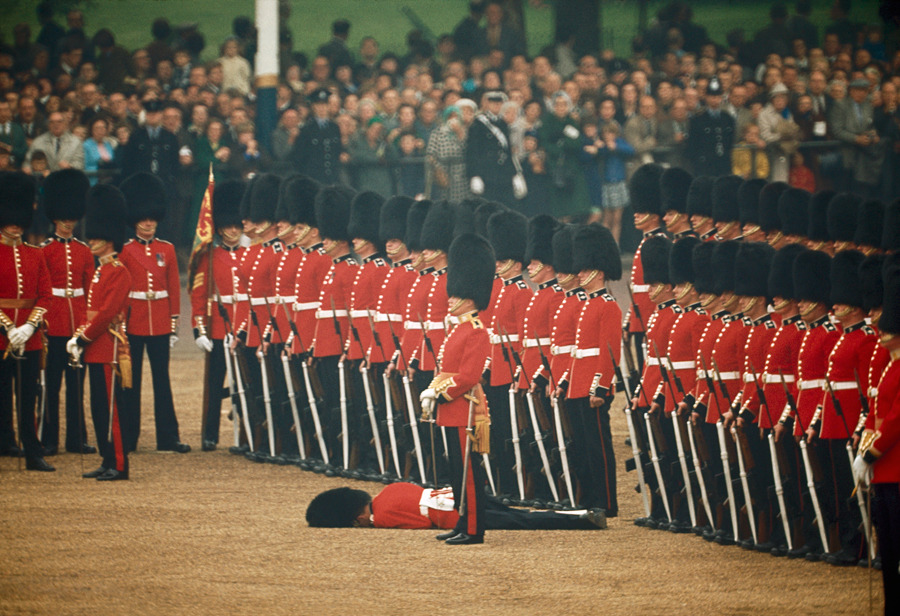 Irish Guards remain at attention after one guardsman faints in London, England, June 1966.Photograph by James P. Blair, National Geographic