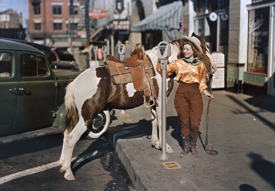 A cowgirl puts a nickel in an El Paso parking meter to hitch her pony, October 1939.Photograph by Luis Marden, National Geographic