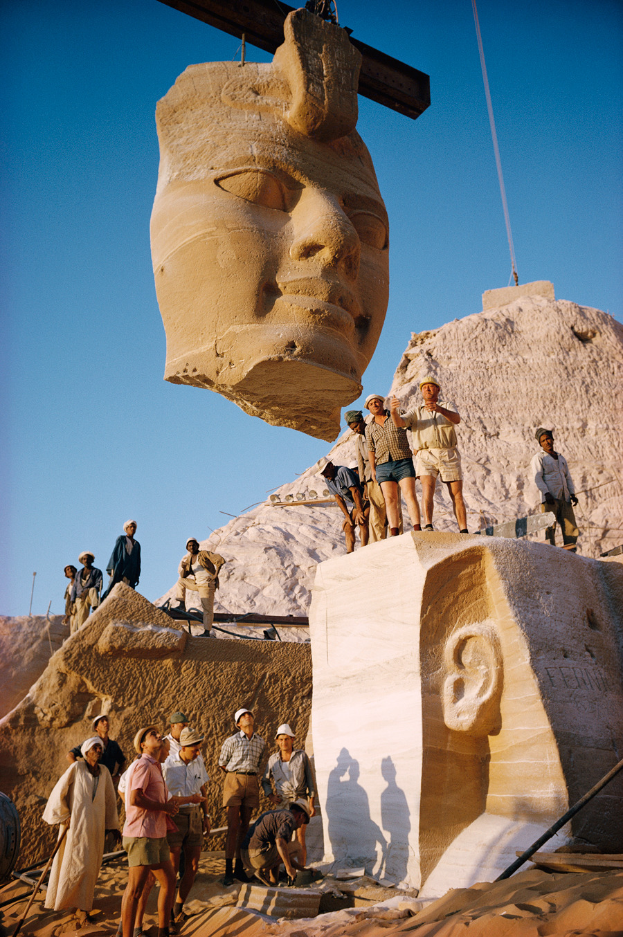 Cranes lift the face of a statue from the Abu Simbel Temples in Egypt, May 1966.Photograph by Georg Gerster, National Geographic