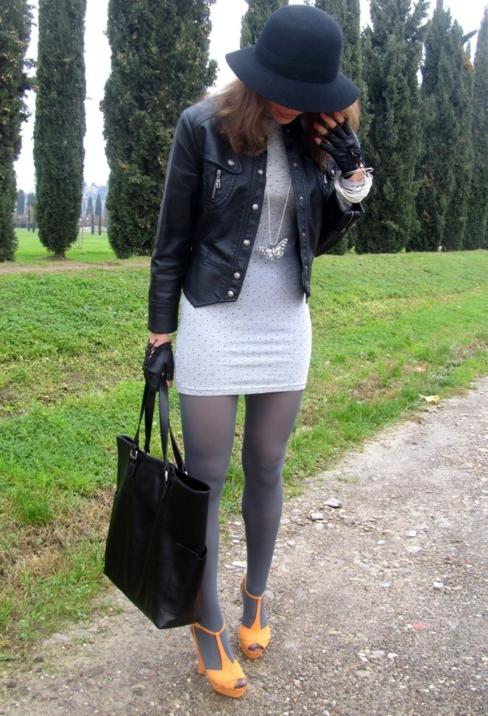 Grey tights with skin tight dress, leather jacket and orange pumps. Stunning fall style !