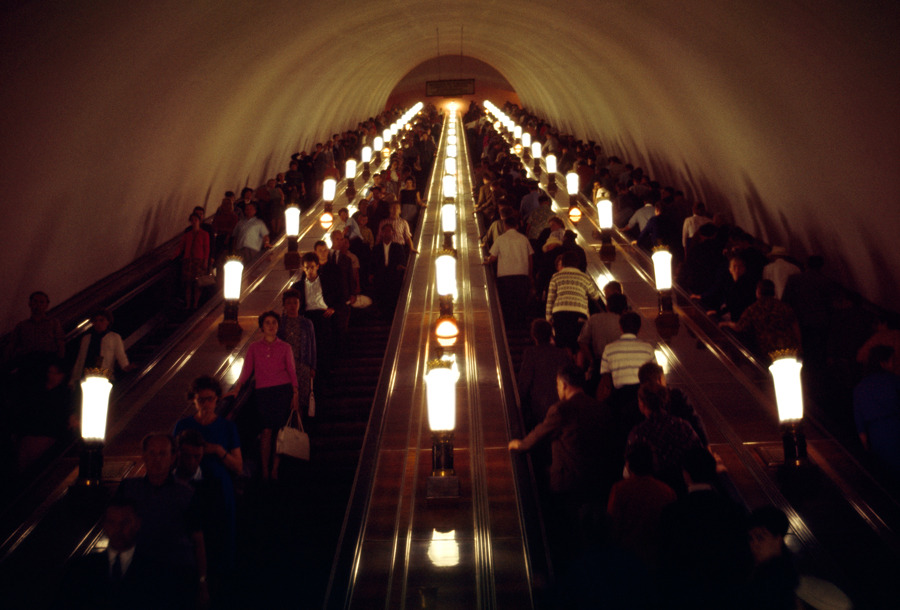 Commuters travel on a four-lane escalator in Moscow's subway system, March 1966.Photograph by Dean Conger, National Geographic