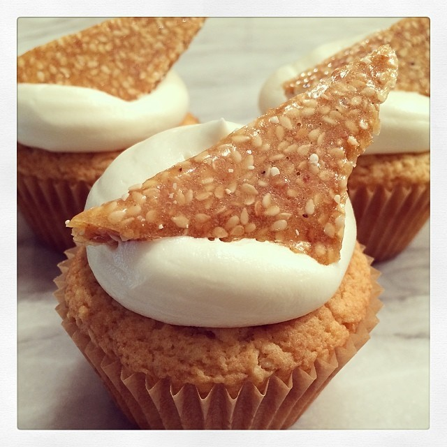 Toasted Sesame Crunch Cipcakes - toasted sesame vanilla cake, topped with local Spring honey cream cheese buttercream and a triangle of sesame crunch candy