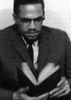 Malcolm X reads.