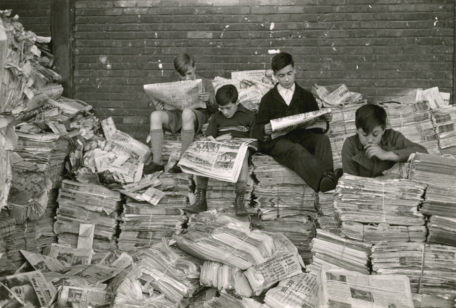 Reading the news in France.Photograph by Maynard Owen Williams, National Geographic
