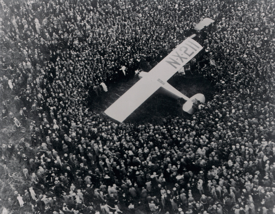 Charles Lindbergh pays a visit to crowds in Surrey, England in his monoplane dubbed the 'Spirit of St. Louis,' June 1927.Photograph by Corbis