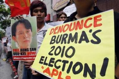 Members of the Free Burma Coalition Philippines hold posters and picture of Aung San Suu Kyi during a protest in front of the Myanmar embassy in Makati's financial district of Manila September 24, 2010. The protesters joined in the international commemoration of the third anniversary of the Saffron Revolution in Myanmar, the 2007 protests during which barefoot, shaven-headed monks shielded and led civilians to march against rising fuel prices which snowballed into the biggest challenge to military rule since a 1988 uprising. REUTERS/Romeo Ranoco