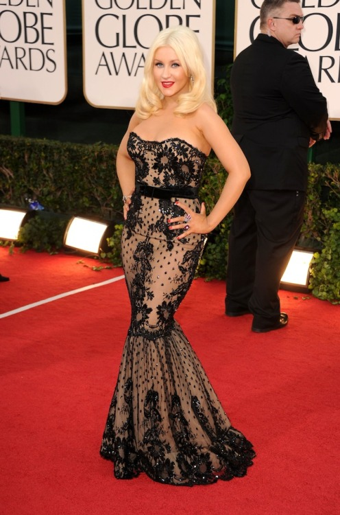 Christina Aguilera's dress is quite booby-ful.