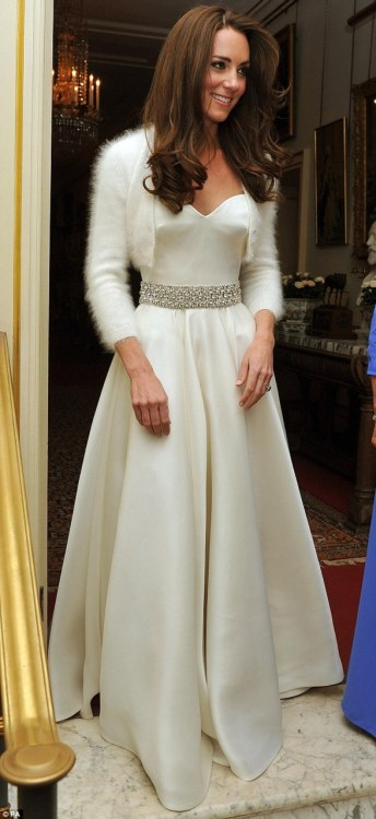 dirtyprettything:  Catherine, Duchess of Cambridgeshire wearing another Sarah Burton creation, this time a white satin evening dress with a circle skirt and diamante embroidered detail round the waist.