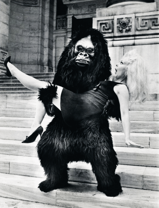 "Greta Thyssen does the blonde captive bit on the steps of New York's public Library with the help of a shaggy sidekick during the city's annual ""Salute to Fall""….10-12-1967"