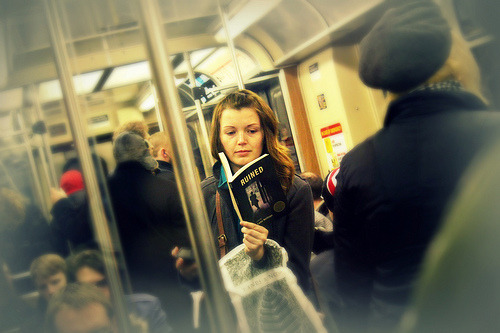 teachingliteracy:</p> <p>Reading on the train (by vuttaro)<br />