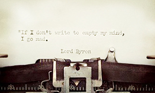 Typewriter with page that read: 'If I don't write to empty my mind, I go mad.' - Lord Byron
