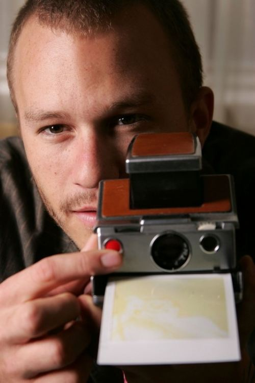 Heath Ledger with a polaroid land camera