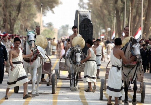 Iraqi actors evoke their ancient Babylonian history during a performance in the city of Hilla, in Babel province, on October 23, 2008, in celebration of the official transfer of security from the US Army to the Iraqi Army for the province.