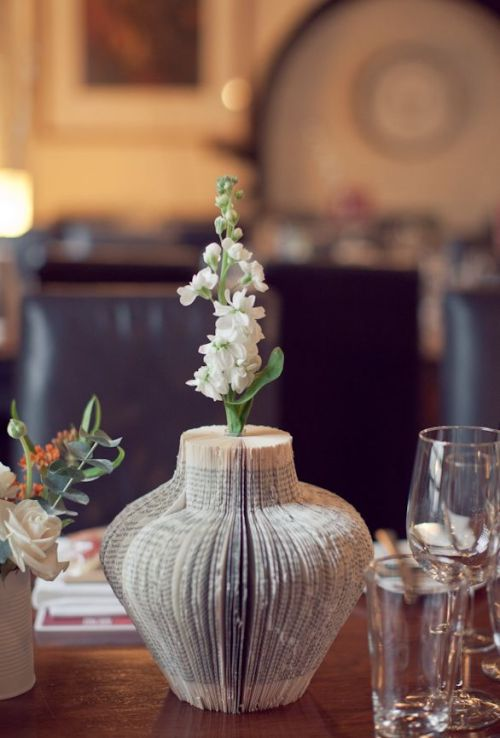 A vase made from book pages…it even has a flower in it!