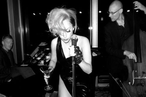 Gaga singing a song at the hotel bar.