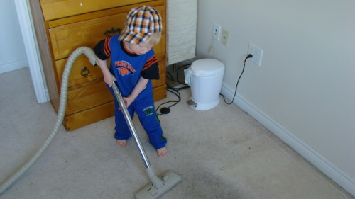 kid using vacuum - potty training